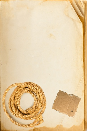 Old book page, hemp rope and cardboard blank with space for your text photo