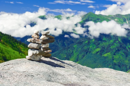 zen like: Stone towers. Two pyramid of meditation zen stones at mountains landscape