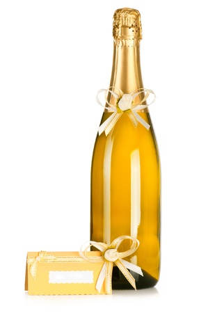 Corked bottle of champagne with wedding decoration flower boutonniere and invitation card on white background photo