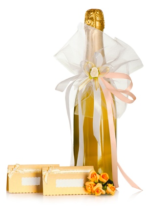 corked: Corked bottle of champagne with wedding decoration bow, flower boutonniere and invitation cards on white background