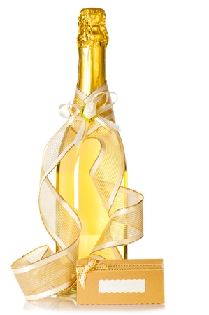 Corked bottle of champagne with wedding decoration ribbon, flower boutonniere and invitation card on white background photo
