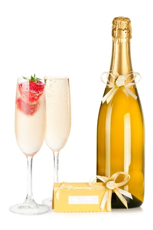 alcohol cardboard: Two glasses and bottle of champagne with strawberry and invitation card