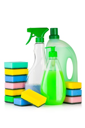 House cleaning supplies. Plastic bottles with detergent and sponge isolated on white background Фото со стока