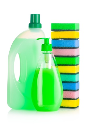 dish washing: House cleaning supplies. Plastic bottles with detergent and sponge isolated on white background Stock Photo