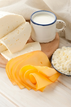 Breakfast with milk and cheese on old wooden table with linen tablecloth photo