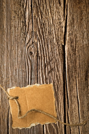 Old wooden texture and cardboard blank on rope with space for your text photo