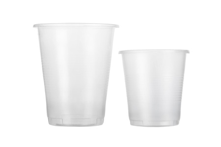 Two empty disposable plastic glass isolated on white background photo