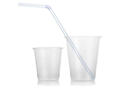 Two empty disposable plastic glass and straw isolated on white background photo