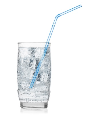 Glass of iced mineral water with straw isolated on white. Stock Photo - 12429889