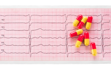 Cardiology  Macro of ECG graph and cardio pills Фото со стока