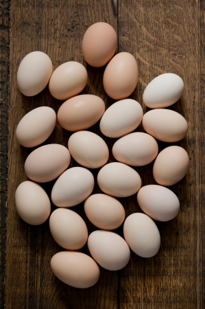 Brown eggs at wooden table background  Shallow depth of field photo