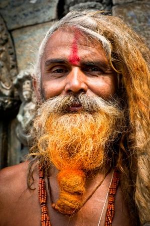 sadhu: Portrait of Holy Sadhu man with dreadlocks and traditional painted face. Nepal, Kathmandu, Pashupatinath Temple. September 21, 2012