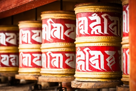 Buddhist prayer wheels in Tibetan monastery with written mantra  India, Himalaya, Ladakh