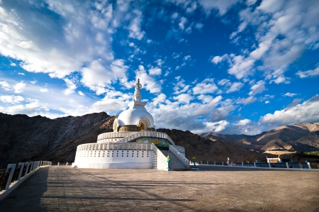 Modern Buddhist monument Shanti Stupa in the evening sunset  Leh, Ladakh, India photo
