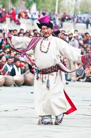 folk heritage: LEH, INDIA - SEPT 08: Man in traditional Tibetan clothes performing folk dance.  Annual Festival of Ladakh Heritage in Leh, India. September 08, 2012