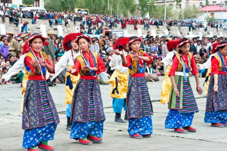 folk heritage: LEH, INDIA - SEPT 08: Young dancers in traditional Tibetan clothes performing folk dance.  Annual Festival of Ladakh Heritage in Leh, India. September 08, 2012 Editorial