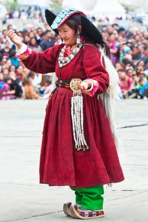 folk heritage: LEH, INDIA - SEPT 08: Woman in traditional Tibetan clothes performing folk dance.  Annual Festival of Ladakh Heritage in Leh, India. September 08, 2012