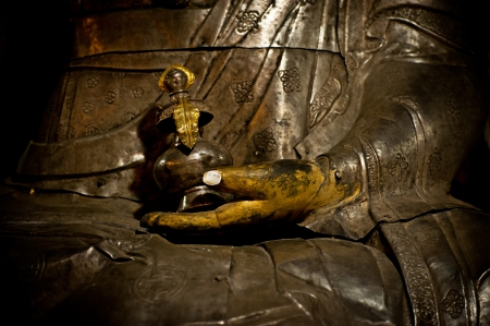 Buddha s hand  Golden Buddha statue in Tibetan Monastery  India, Ladakh, Hemis Monastery photo