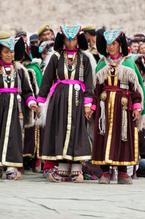 folk heritage: LEH, INDIA - SEPTEMBER 08, 2012: Women in traditional Tibetan clothes performing folk dance.  Annual Festival of Ladakh Heritage in Leh, India. September 08, 2012 Editorial