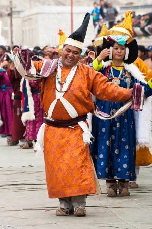 folk heritage: LEH, INDIA - SEPTEMBER 08, 2012: Artists in traditional Tibetan clothes performing folk dance.  Annual Festival of Ladakh Heritage in Leh, India. September 08, 2012