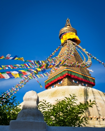 Buddhist Shrine Boudhanath Stupa with pray flags over blue sky. Nepal, Kathmandu Stock Photo - 16164031