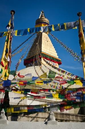 Buddhist Shrine Boudhanath Stupa with pray flags over blue sky. Nepal, Kathmandu Stock Photo - 16164038