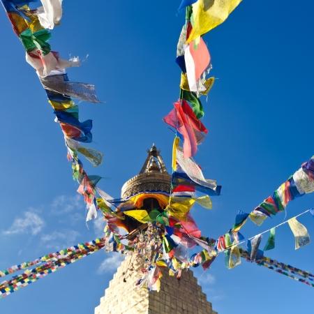 Buddhist Shrine Boudhanath Stupa with pray flags over blue sky. Nepal, Kathmandu Stock Photo - 16163992