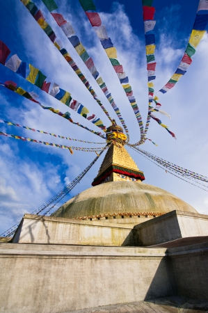 Buddhist Shrine Boudhanath Stupa with pray flags over blue sky. Nepal, Kathmandu Stock Photo - 16164015