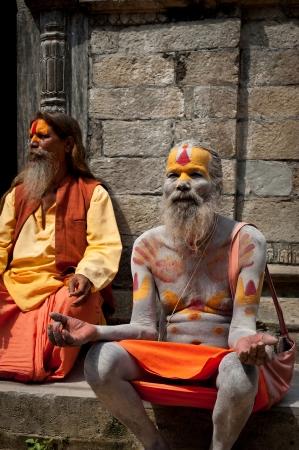KATHMANDU, NEPAL, PASHUPATINATH TEMPLE - SEPTEMBER 21: Holy Sadhu men with traditional painted face, blessing in Pashupatinath Temple. Nepal, Kathmandu. September 21, 2012 Stock Photo - 16205969