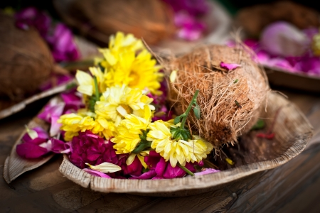 Flower and coconut offerings for Hindu religious ceremony or holy festival Stock Photo