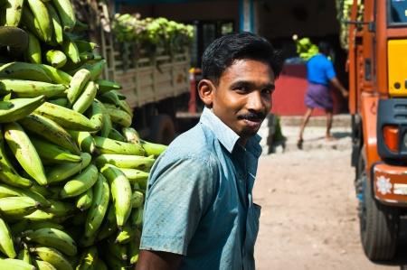 ALAPPUZHA INDIA - February 23: Indian man with a cargo of bananas going to market place. India, Kerala, Alappuzha. February 23, 2013 Stock Photo - 18468795