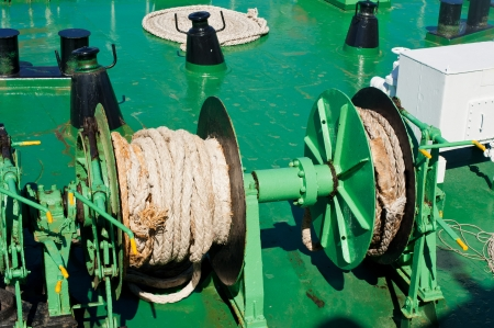 Traveling by sea  Close up rope on mechanism at ferry boat deck photo