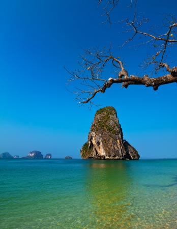 Tropical beach landscape with rock formation island and ocean. Pranang cave beach, Railay, Krabi, Thailand photo