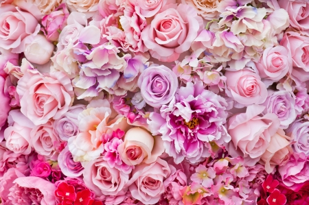 Floral background. Lot of artificial flowers in colorful composition photo
