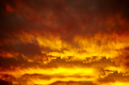 heaven and hell: Dramatic background with cloudy sky at burning sunset