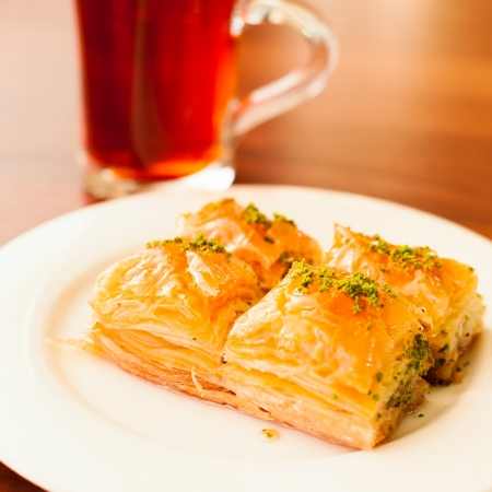 Oriental sweets baklava served with cup of tea Stock Photo
