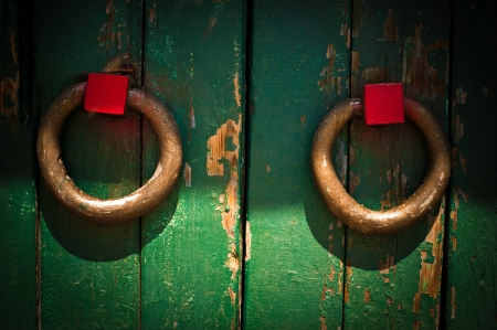 Vintage handle on wooden door with cracked paint  Grunge colorful background in vintage style photo