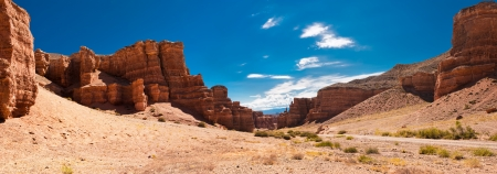 color range: Sunny day at Charyn canyon  State National Paleontology Park in Kazakhstan  Three images panorama Stock Photo
