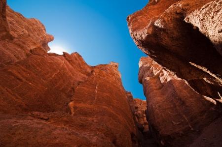 paleontology: Rock formations at Charyn canyon under blue sky. State National Paleontology Park in Kazakhstan Stock Photo