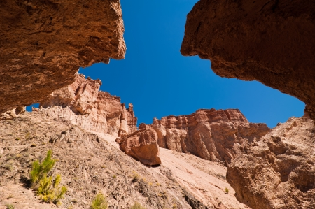 Rock formations at Charyn canyon under blue sky photo