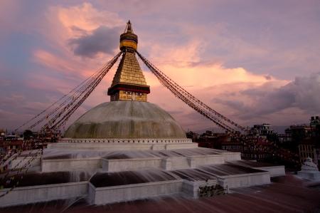 kathmandu: Buddhist Shrine Boudhanath Stupa with pray flags over sunset sky. Nepal, Kathmandu