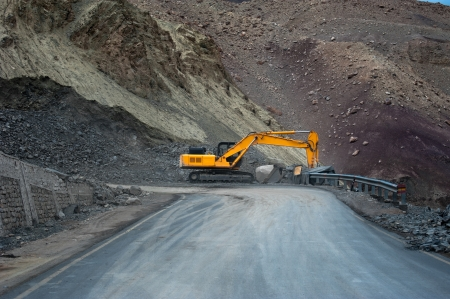 digger: Heavy road construction car in Himalaya mountains. India, Ladakh, altitude 4500 m