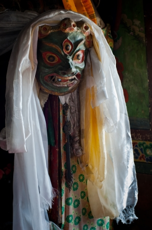 gompa: Ancient Mahakala dance mask at Lamayuru Buddhist monastery temple decorated in traditional tibetan style  India, Ladakh, Lamayuru Gompa