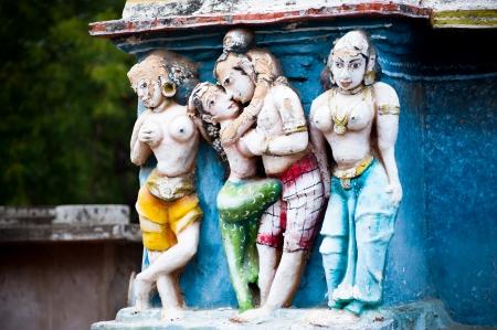 Hindu religious art. Ancient statue pantheon of Gods at Temple gopura (tower) facade. South India, Tamil Nadu photo