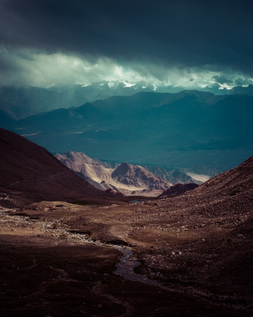 Himalaya high mountain landscape panorama with dramatic cloudy sky. India, Ladakh. Vintage style processing image photo