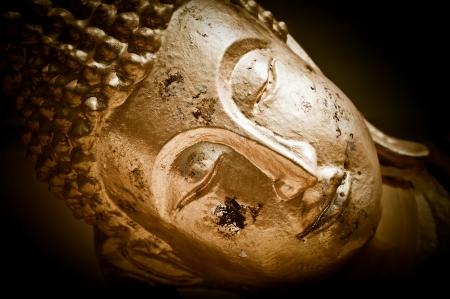 buddha image: Close up face of Golden Buddha. Wat Phra Yai Temple. Koh Samui island, Thailand. High contrast Image in vintage style, sepia toned