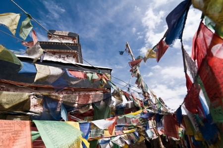 gompa: Praying flags over blue sky at Buddhist monastery. India, Ladakh, Spituk Gompa
