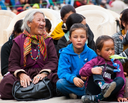 folk heritage: LEH, INDIA - SEPTEMBER 08, 2012: Unidentified Tibetan people in traditional clothes enjoying folk festival performance at Annual Festival of Ladakh Heritage in Leh, India. September 08, 2012