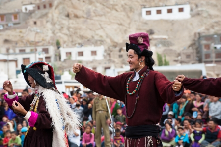 LEH, INDIA - SEPTEMBER 08, 2012: Man in traditional Tibetan clothes performing folk dance. Annual Festival of Ladakh Heritage in Leh, India. September 08, 2012