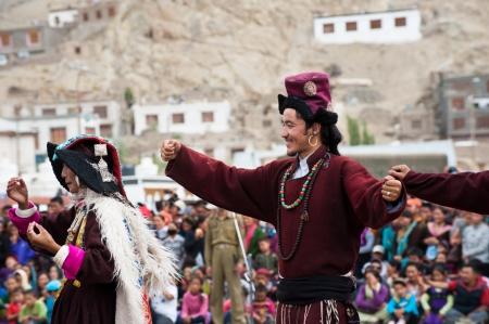 folk heritage: LEH, INDIA - SEPTEMBER 08, 2012: Man in traditional Tibetan clothes performing folk dance. Annual Festival of Ladakh Heritage in Leh, India. September 08, 2012 Editorial